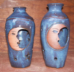 two moonface candle cages hand made blue in color