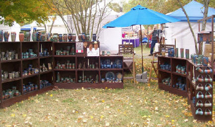 JT Pottery USA Booth of pottery