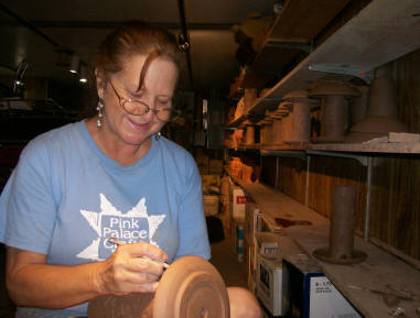 Maggie designing pottery