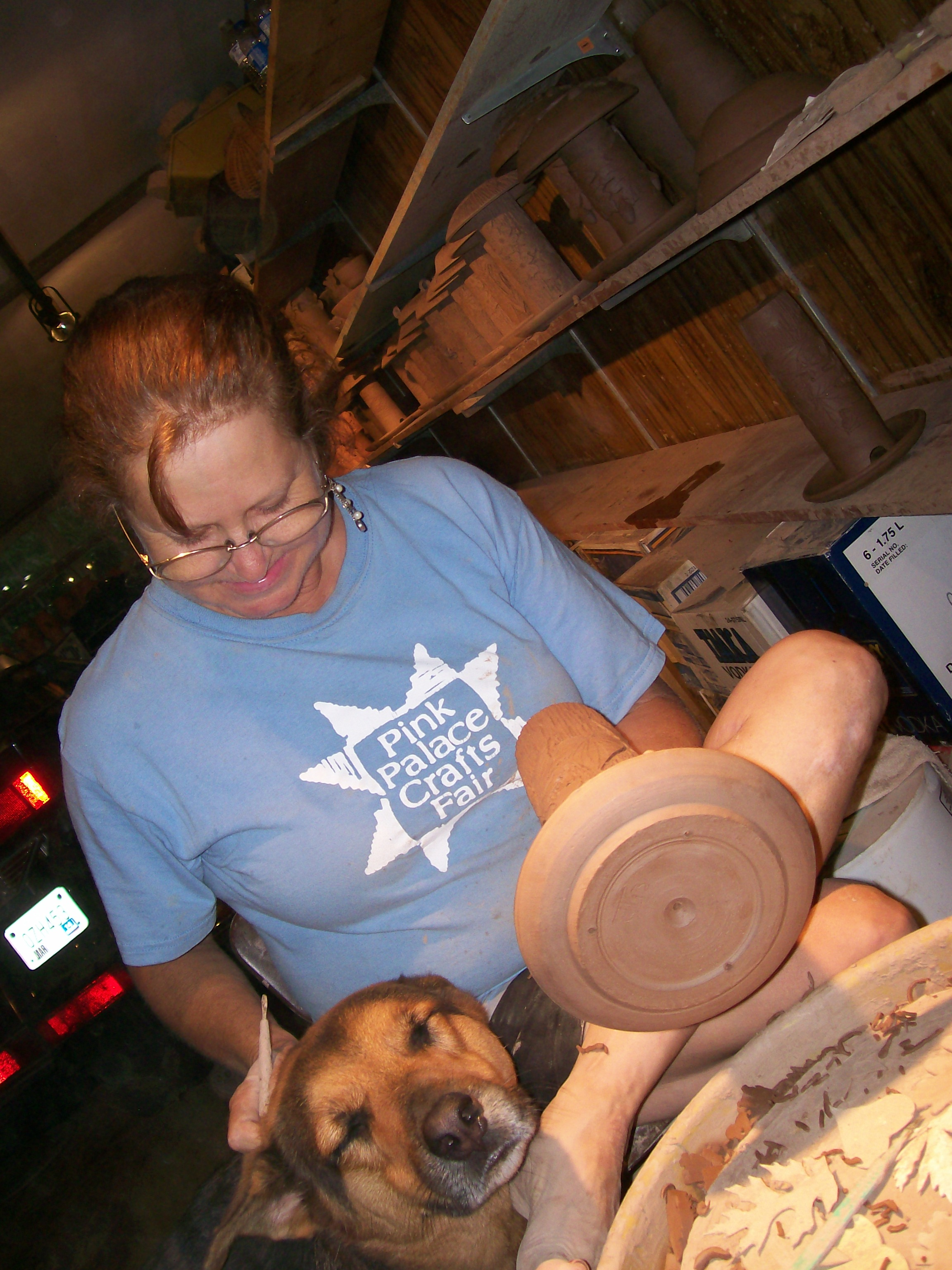 Maggie petting the pottery dog