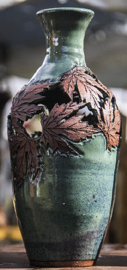 Hand made Pottery vase with etched maple leaf and a green glaze