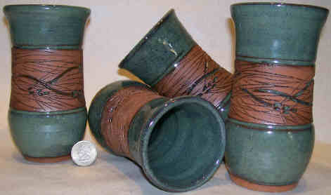 Hand thrown pottery Tumblers with jt pottery's engraved pine design and a soft green color.