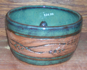 Hand thrown pottery apple/onion baker with the pine design and green glaze