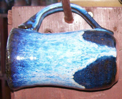 hand mad pottery mug with dark blue and light blue white glaze.