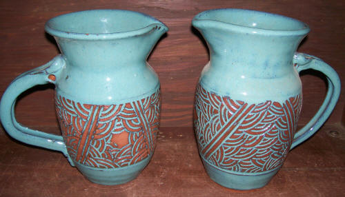 hand thrown Pottery pitcher make by JTPottery with curtains design